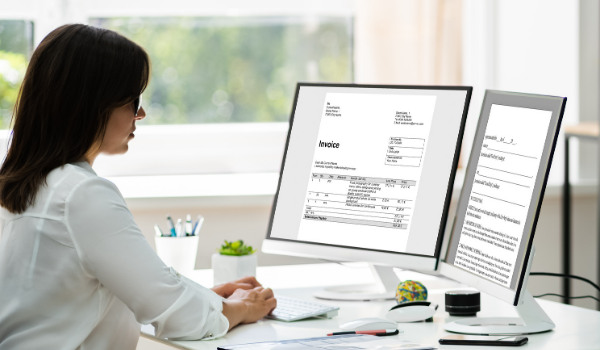 woman working on an invoice on the computer