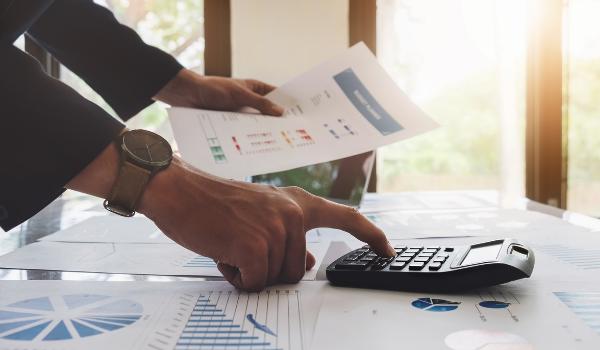 person calculating revenue