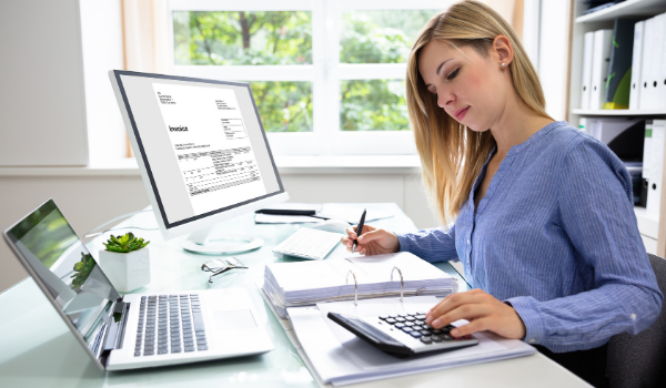 woman working on accounting at a desk