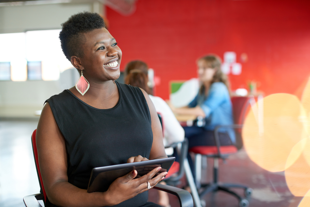 Confident female association member participating in online learning opportunity