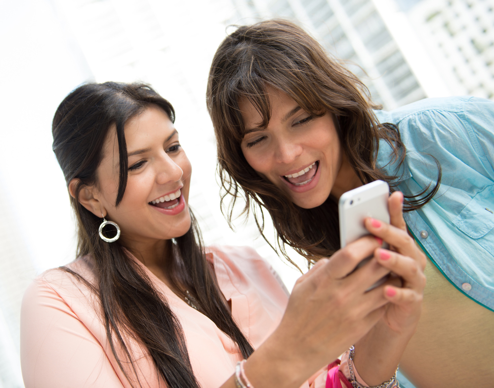 Happy women using app on a cell phone